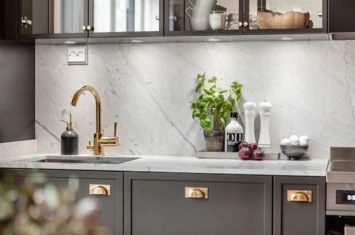 An Elegant Dark Gray And Brass Details