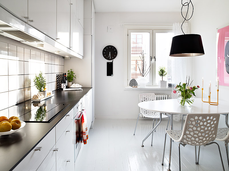 white kitchen and dining design