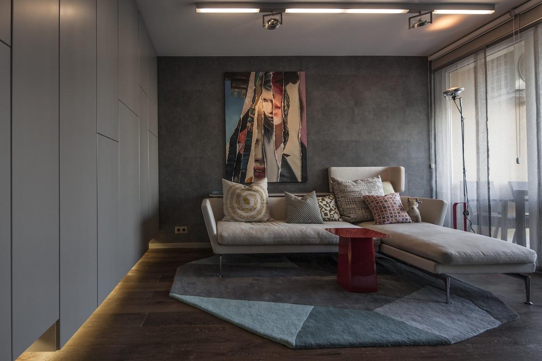 Industrial apartment design with dark interior