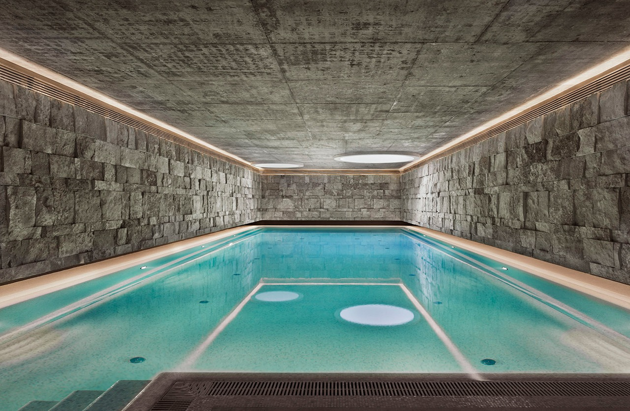 Indoor swimming pool with stone decoration