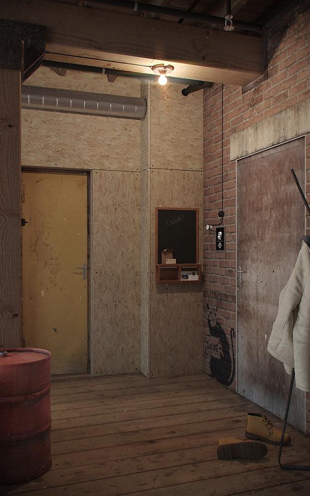 studio apartment exposed brick wall