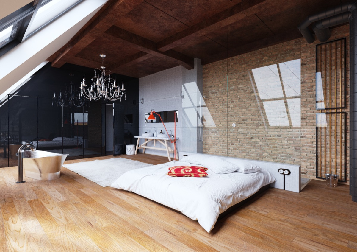 low-lying-bed-chandelier-exposed-brick-bedroom