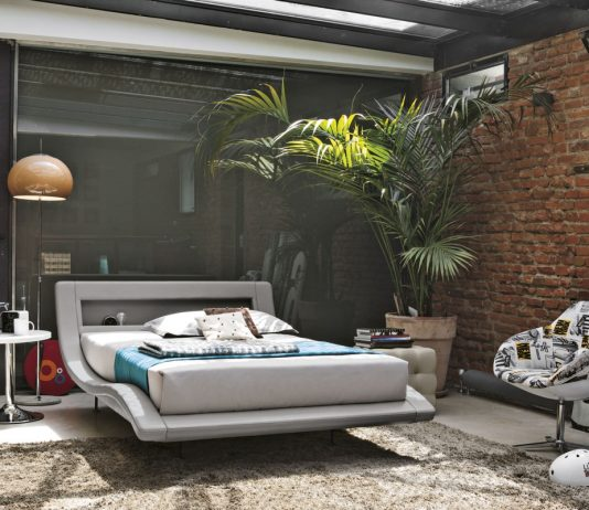 lush-jungle-bedroom-with-exposed-brick