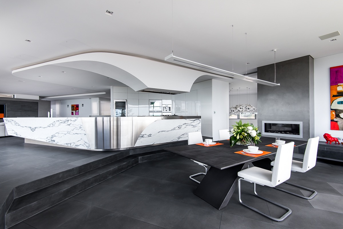 curved-ceiling-leather-chairs-dining-room-black-and-white
