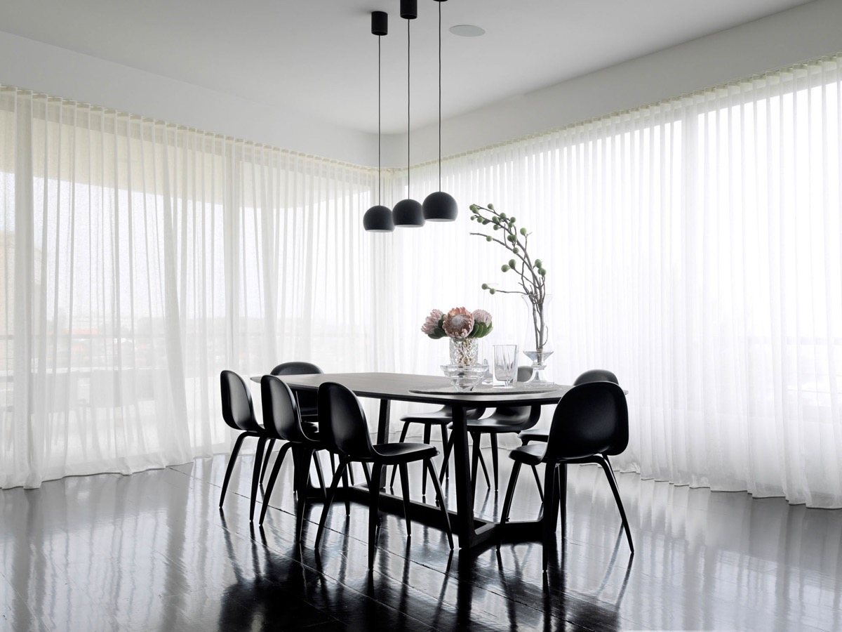 polished-floor-chiffon-curtains-monochrome-dining-room