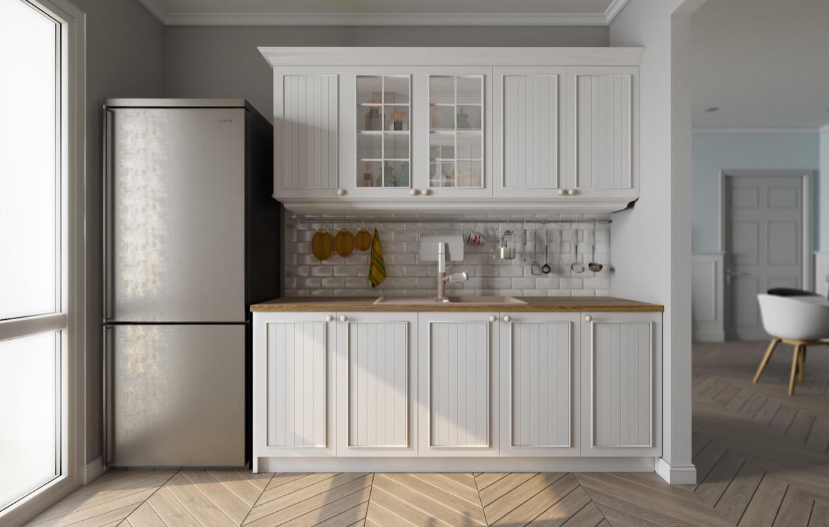 French-cabinets-chrome-fridge-Scandinavian-kitchen
