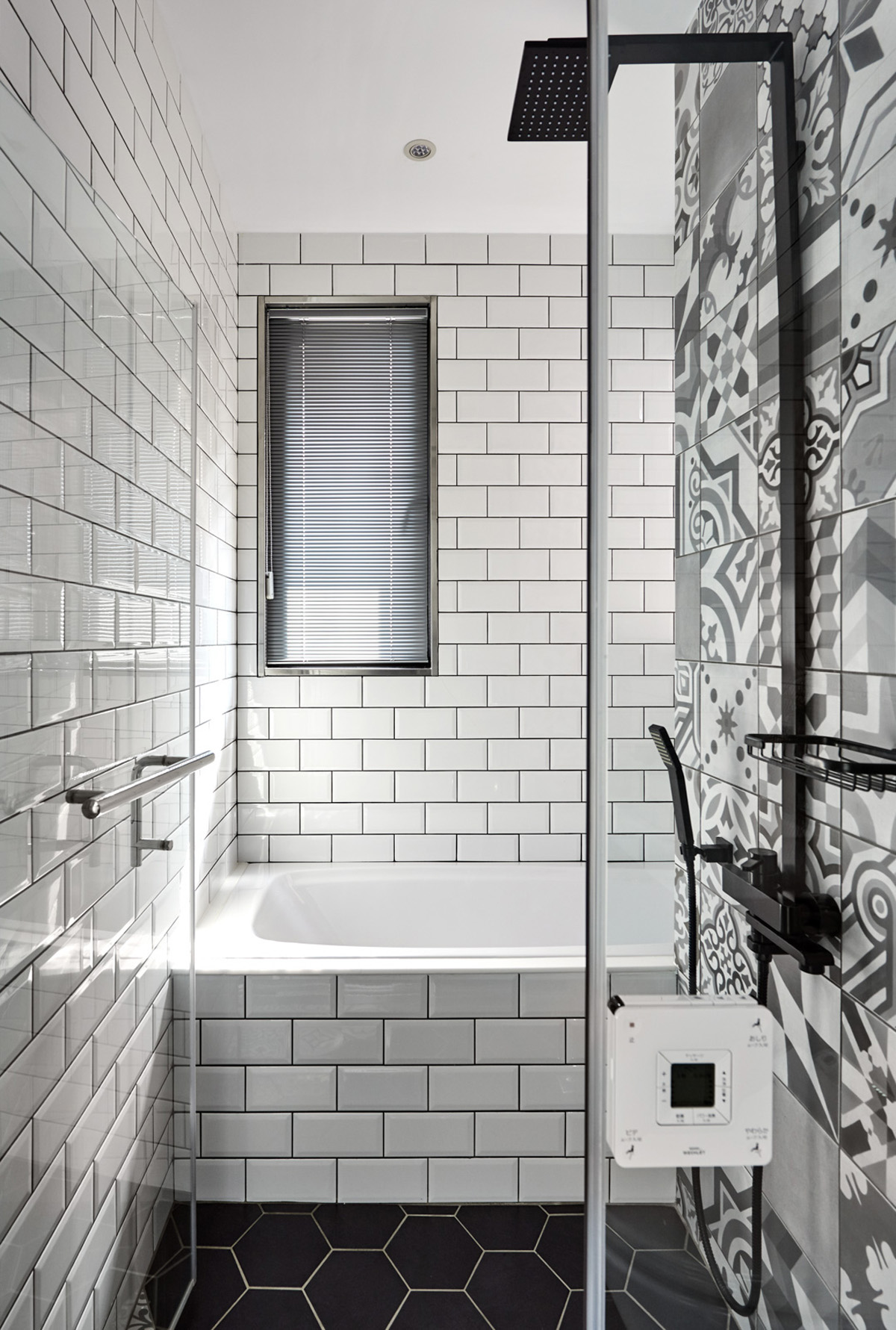 small bathroom with unique tile patterned