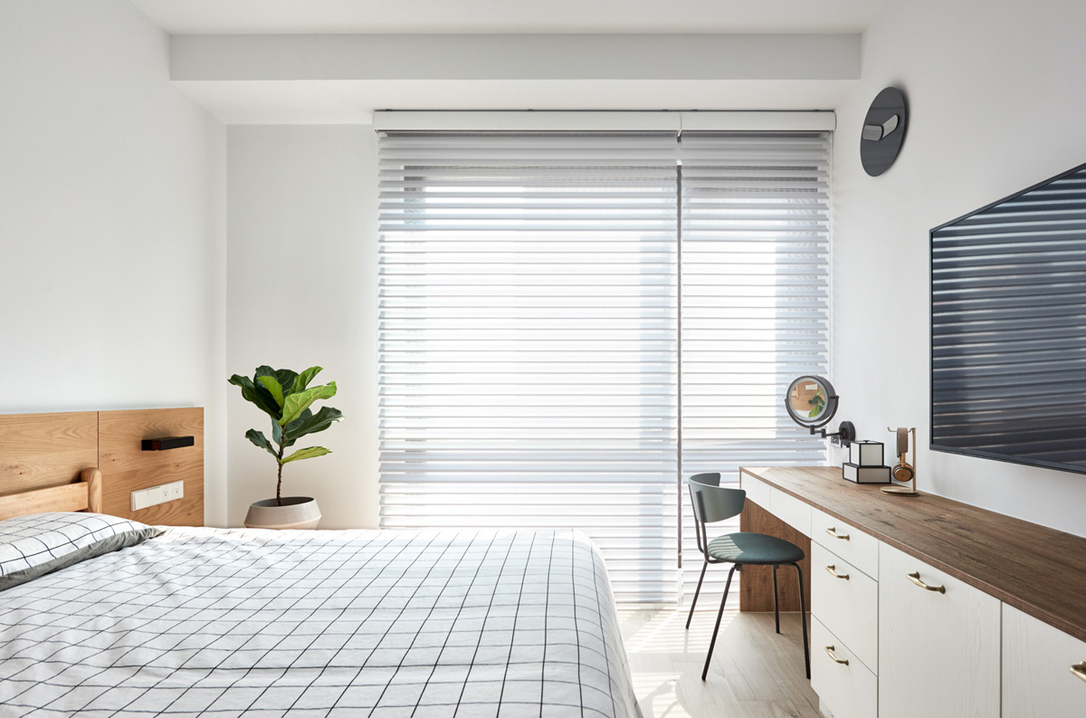 white bedroom with blinds