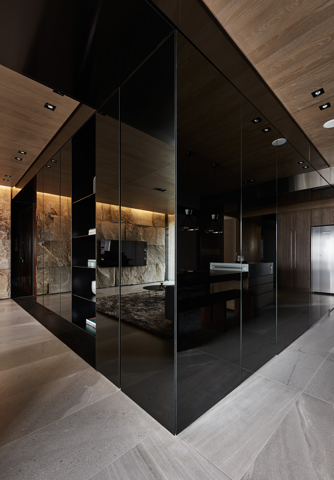marble-floor-black-acrylic-cabinetry-sophisticated-dark-interior
