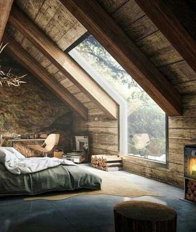 wooden bedroom at the attic