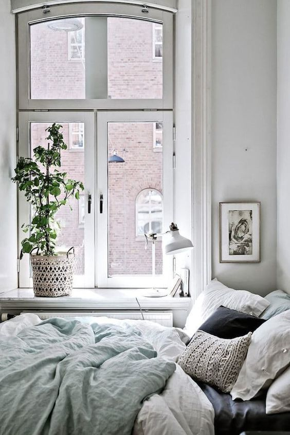 cozy bedroom with bed next to the window
