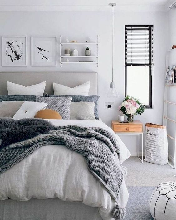 comfortable bedroom with layered bedding
