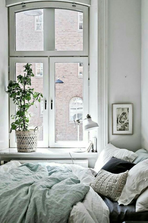 bed next to the window make the bedroom a cozy place