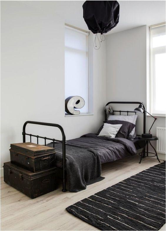 black rug for monochrome bedroom