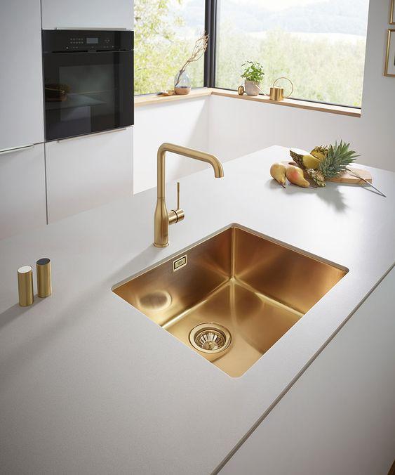 beautiful luxury kitchen with golden sink