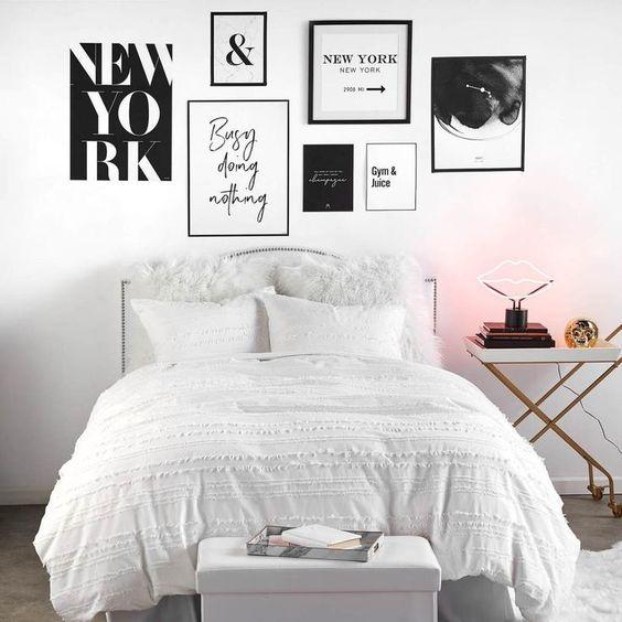 Monochrome bedroom gallery wall