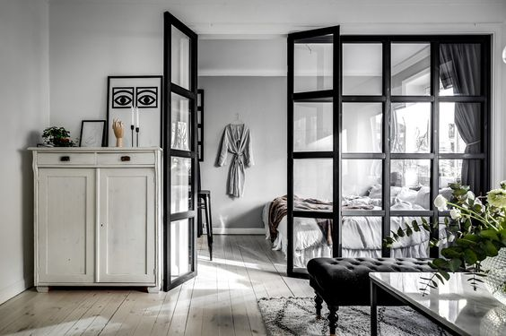 a room barrier to make the small apartment feel more spacious
