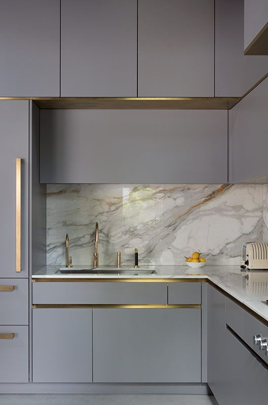 golden cabinet edge make the luxury kitchen look simple