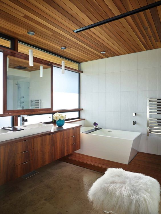 teakwood ceiling to bring warmth to the bathroom